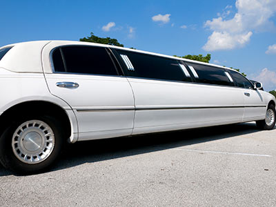 A white limo with blacked out windowsvvv