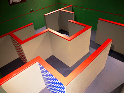 A walled maze in a green painted room