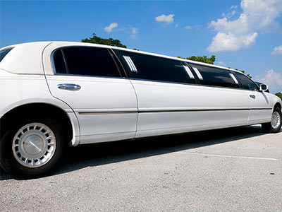 A white limo with blacked out windows