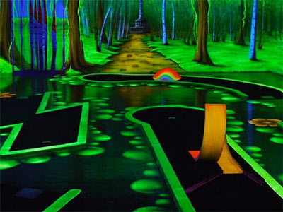The green-lit interior of a glow golf course