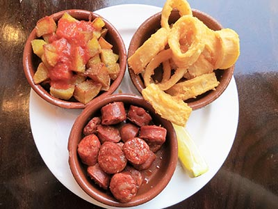 Three small bowls of tapas on a plate