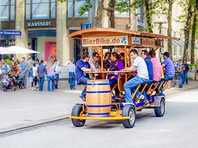 A beer bike driving through the centre of the city