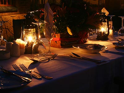 A candlelit table set for dinner