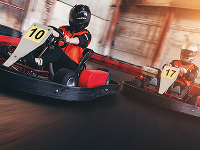 Two people on a track in go karts