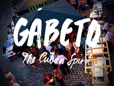 Gabeto's logo written over an image of people eating and drinking outdoors