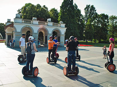 A group of people on segways, outside