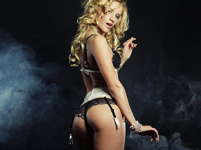 A woman in sexy lingerie on a smoky background