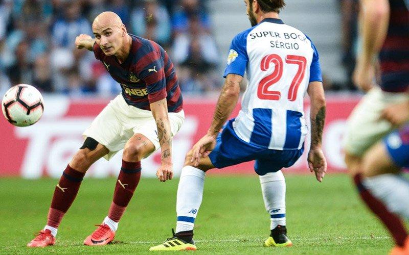 A man kicking a ball during a football match