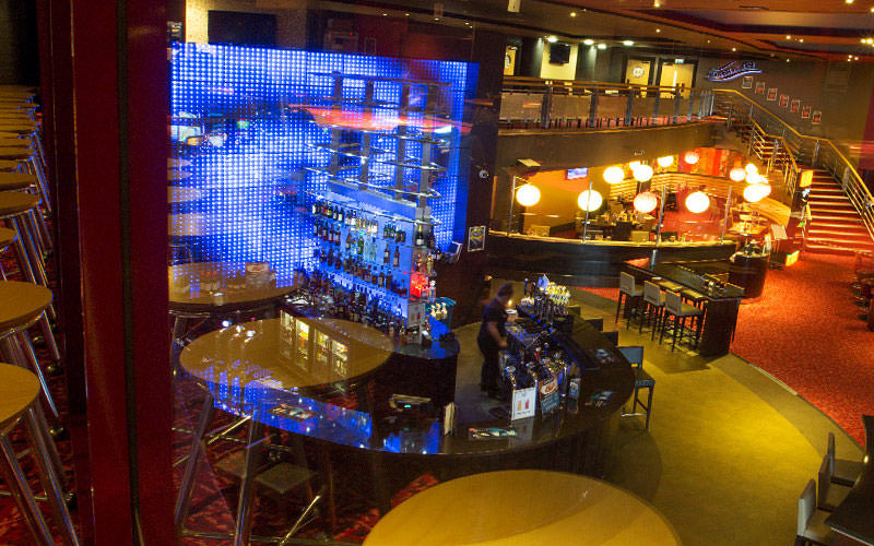 The bar area, with spirits on shelves in the background, at Grosvernor Casino, Liverpool