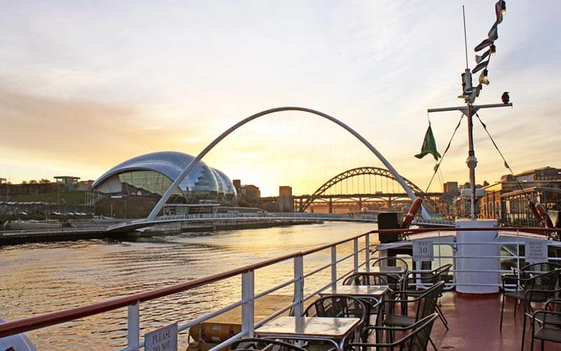 Image from on board the boat looking down the River Tyne with Millenium Bridge, Tyne Bridge and Sage in the background.