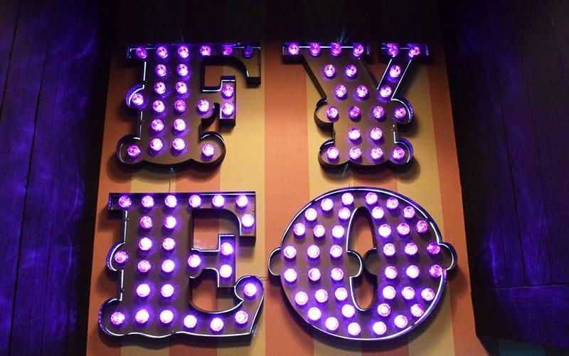 FYEO logo in purple with lights filling each letter.
