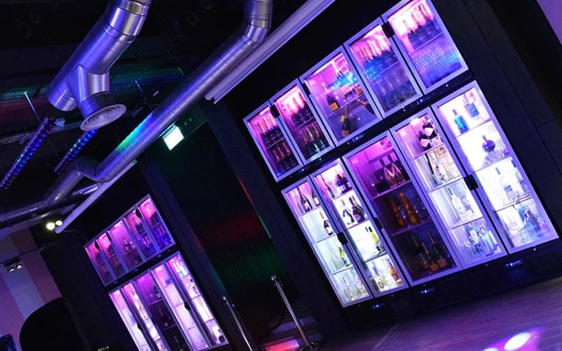 Bar area of For Your Eyes Only Newcastle with fridges illuminated.