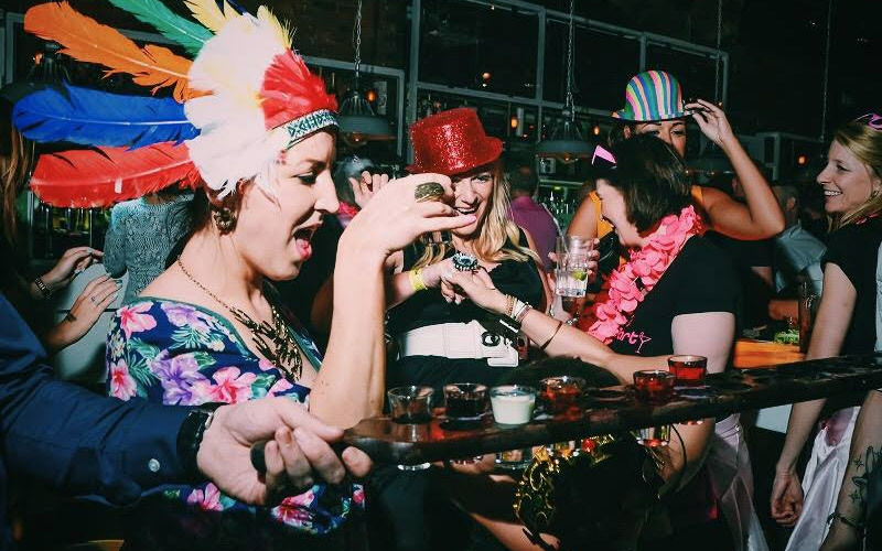 A group of women drinking shots in a nightclub