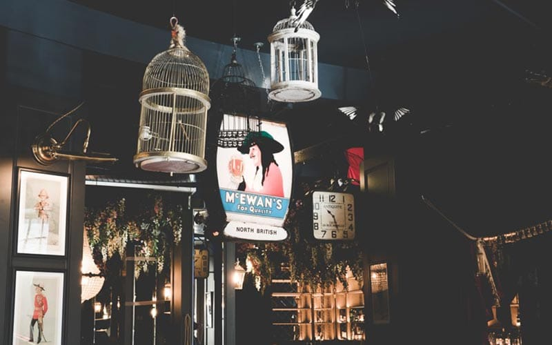 Some bird cages hanging from the ceiling in Colonel Porter's