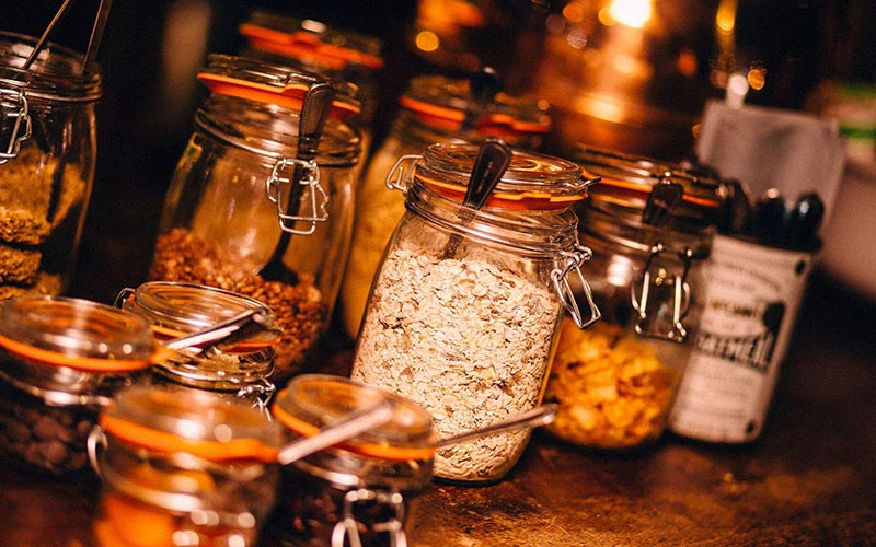 Various jars of ingredients on a table