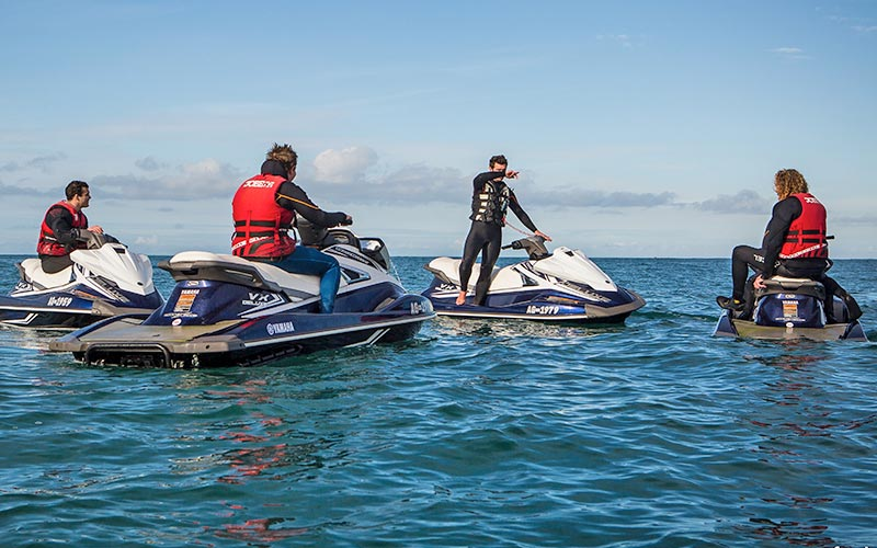 A group of people on jet skis in the sea