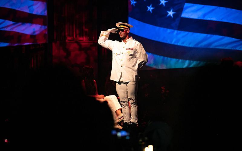 A stripper wearing a navy uniform