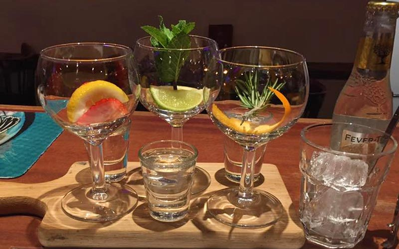Glasses of gin on tray