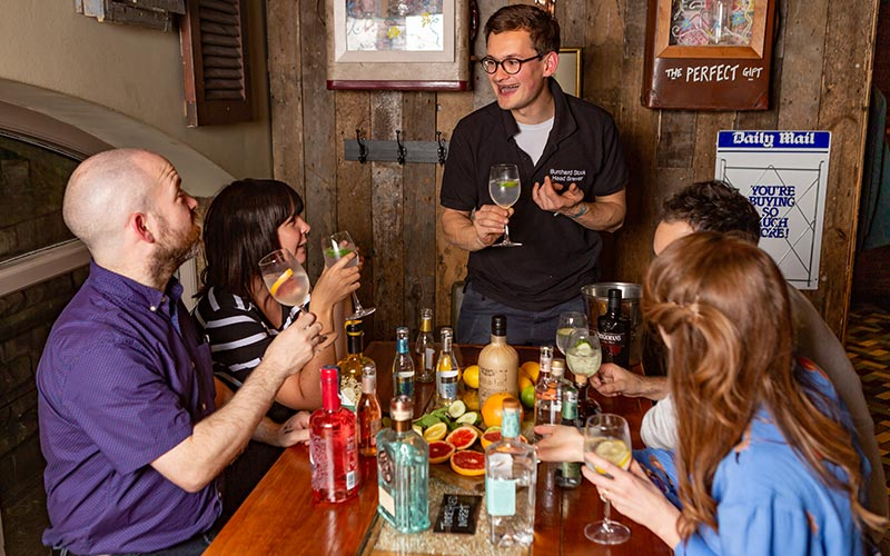 A group of people at a gin tasting class