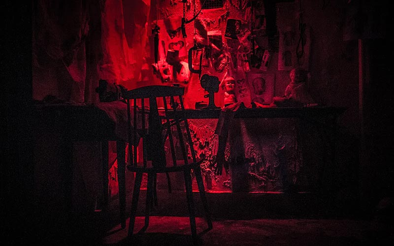 A dark red creepy room