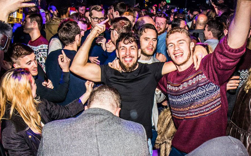 A group of people dancing in a nightclub
