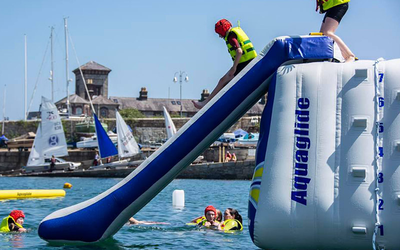 A man going down an inflatable slide
