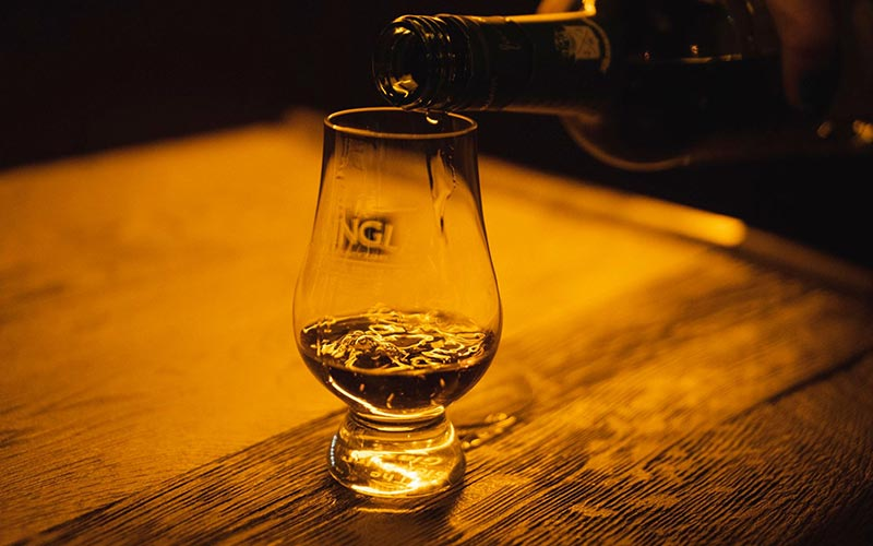 Whiskey getting poured into a glass