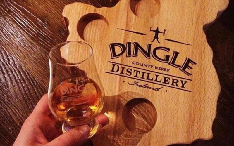 A glass of whisky over a wooden board