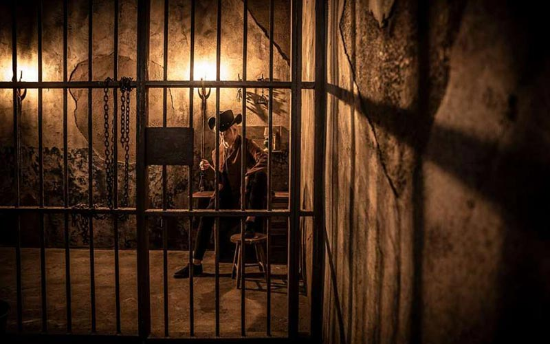 A man sitting down in a cell