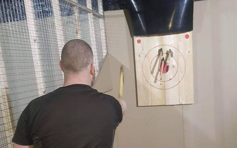 A man throwing an axe at a target