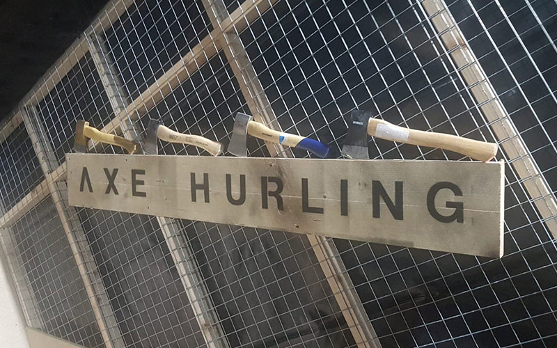 Four axes displayed above a sign that reads