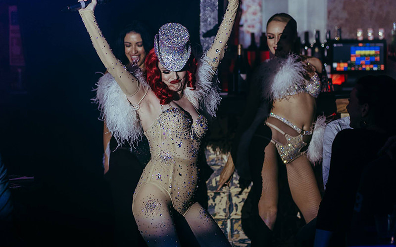 A woman dancing while wearing lingerie