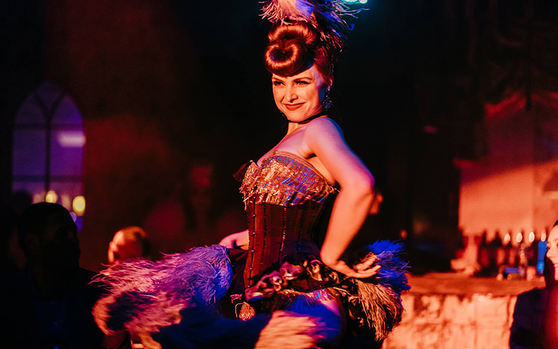 A woman dancing while wearing lingerie and nipple tassels
