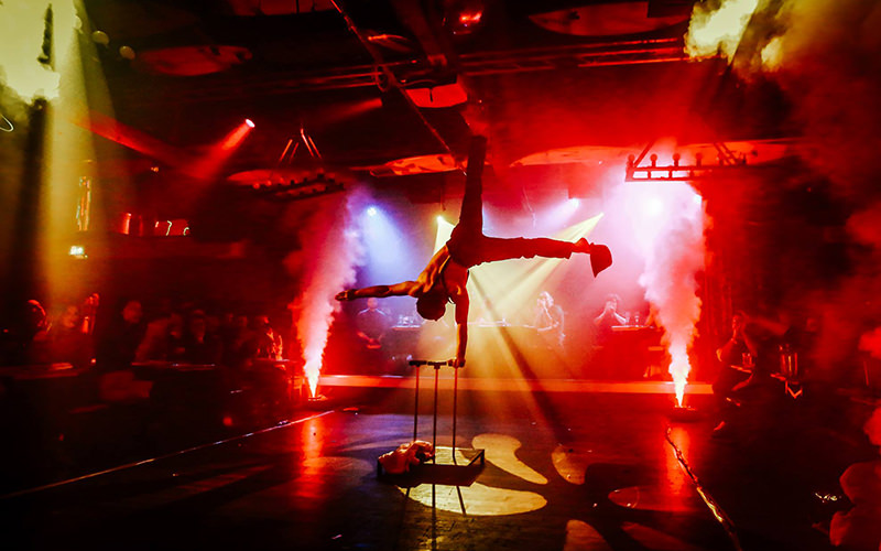 A man performing acrobatics on stage