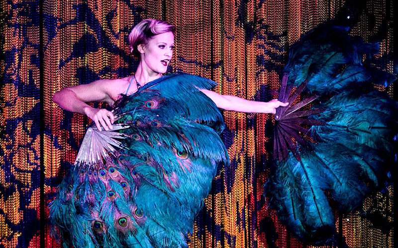 A woman performing with giant feathers