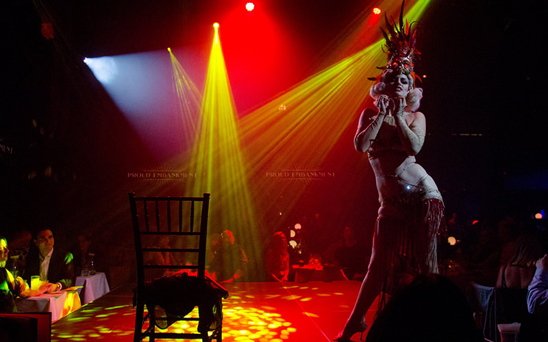 A half-naked woman performing on stage