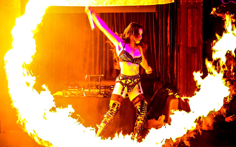 A woman performing with fire on a stage