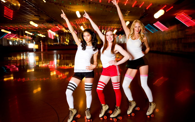 Three girls at a roller disco