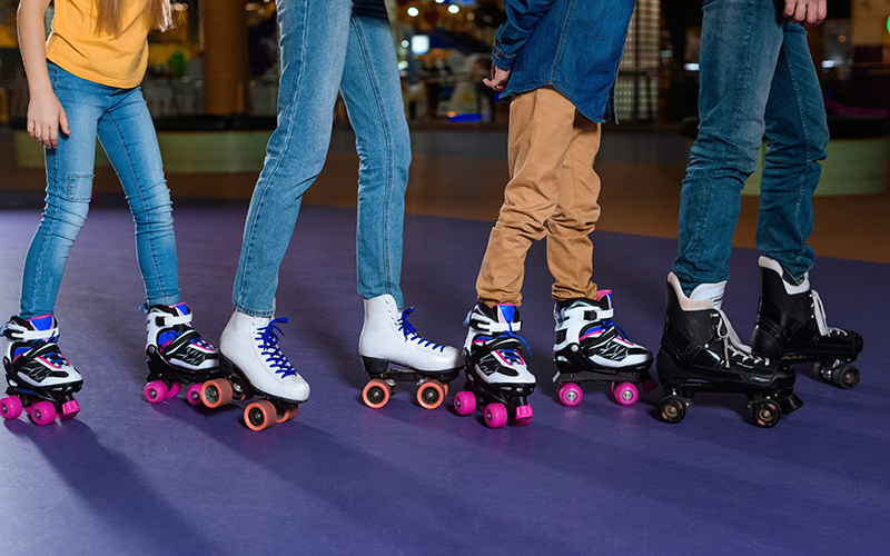A close up of a group of people wearing roller skates