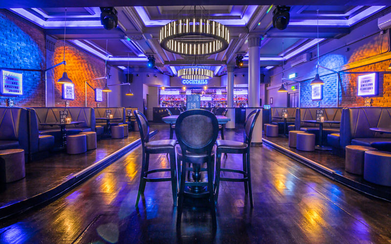 A view of a nightclub venue with several chairs and a large floor