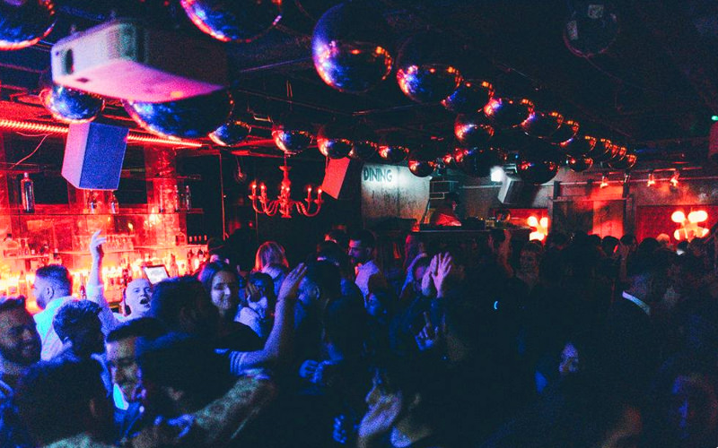 A view of a large crowd dancing in a nightclub