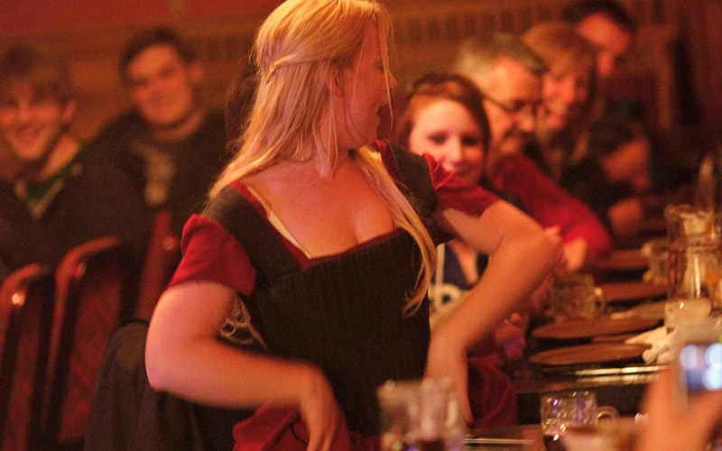 A Medieval bar maid serving drinks