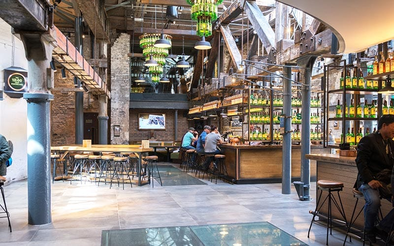 Inside Jameson Distillery, showing the cafe and seating area