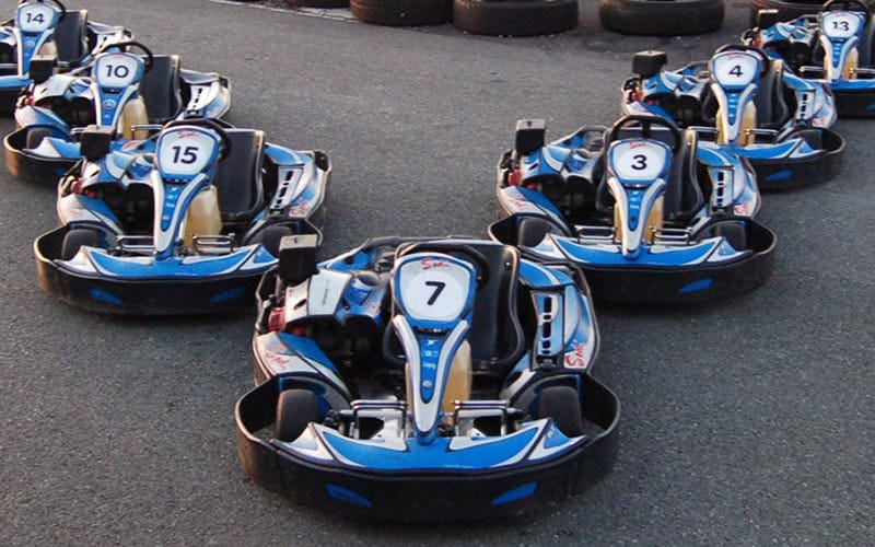 Some go karts lined up in an arrowhead formation