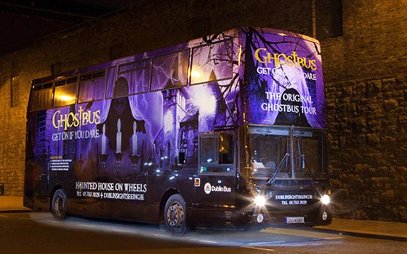 The Dublin Ghost Bus illuminated at night