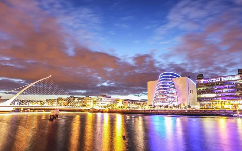 A picturesque view of the River Liffey with lights reflecting in it