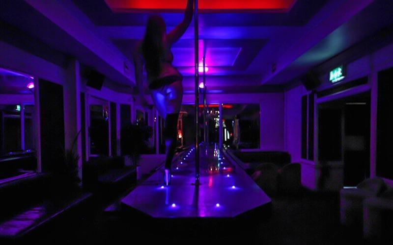 A girl pole dancing in the Dublin strip club