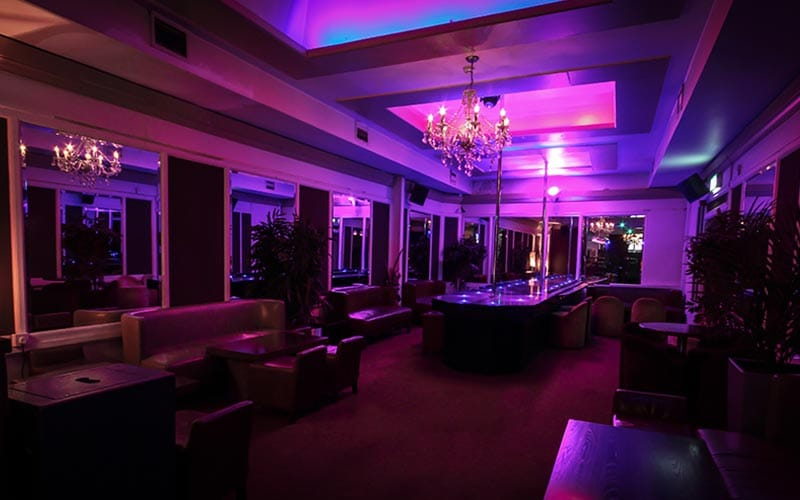 The dimly lit interiors of the strip club in Dublin
