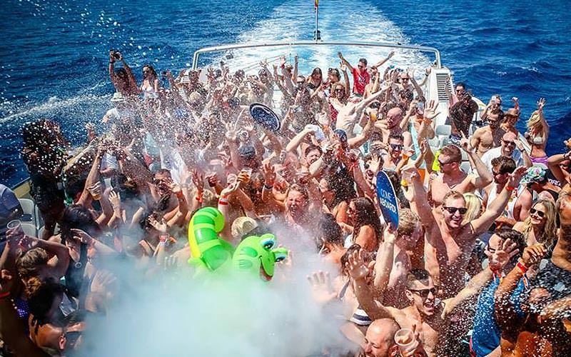Group of people on the top deck of a boat