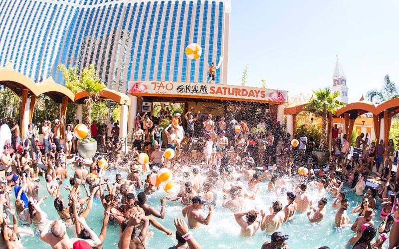 A large group of people at a pool party in TAO Beach Club in Las Vegas
